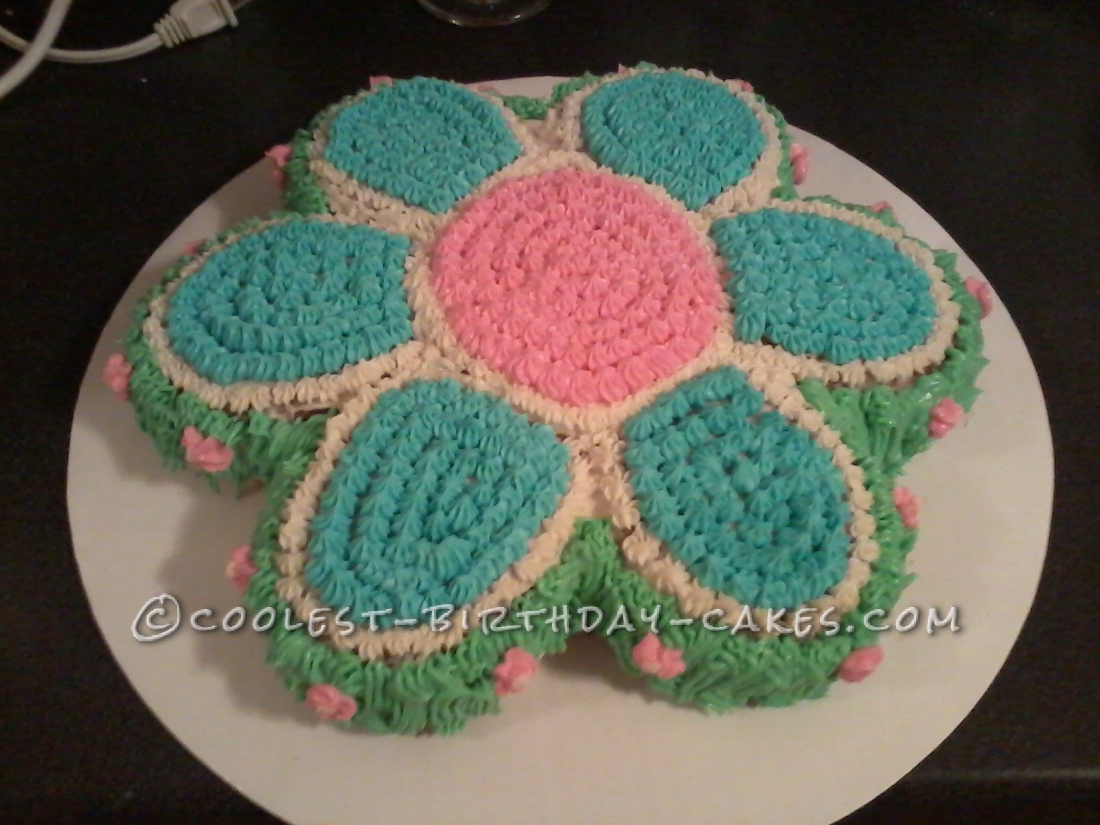 Coolest flower garden cake i made this flower garden cake using the wilton flower cake pan i followed the baking instructions that come with the pan but its usually 350 for 30 40 izmirmasajfo