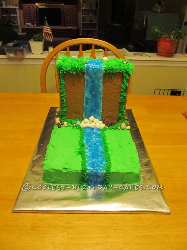 Adding the finishing touches to the waterfall Cake