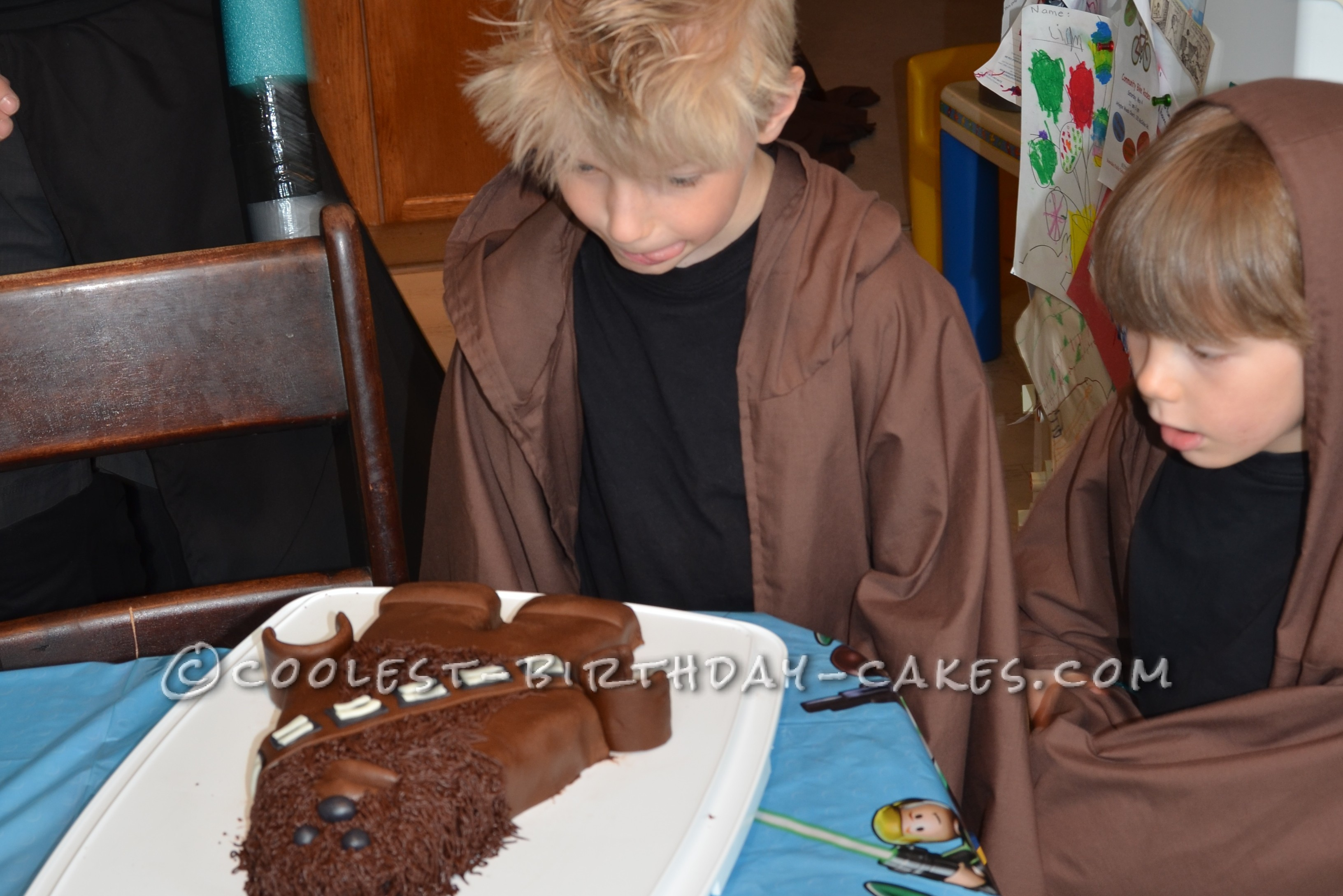 The birthday boy and his brother seeing the cake for the fist time in their homemade Jedi robes.