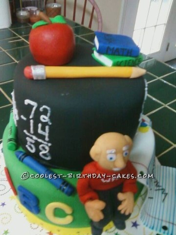 Blackboard tier with apple, books and pencil top