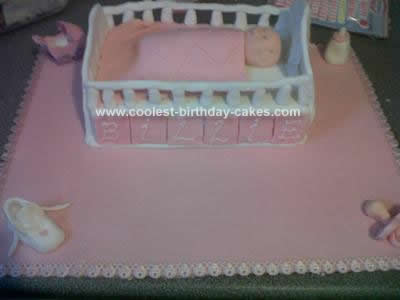 coolest-baby-cot-cake-38-21484937.jpg