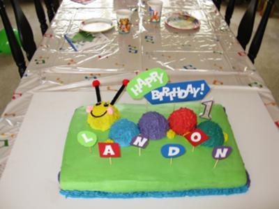 coolest-baby-einstein-caterpillar-first-birthday-cake-21328400.jpg