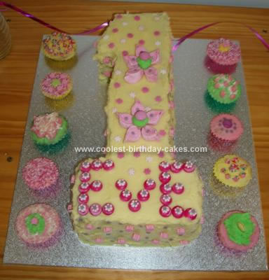 Cool Homemade Yellow And Pink First Birthday Cake And Cupcakes