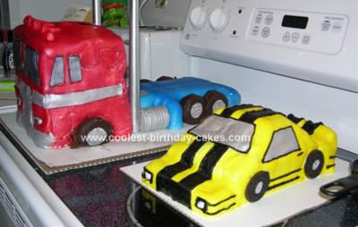 Homemade Optimus Prime And Bumble Bee Cake