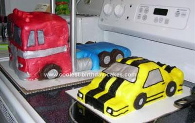 Homemade Optimus Prime And Bumble Bee Cake